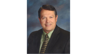 RTA Promotes of Gene A. Rhodes